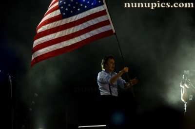 Paul McCartney carries the US Flag July 31 2011 Wrigley Field Chicago Il