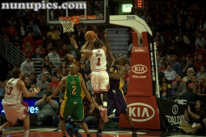 Chicago Bulls vs New Orleans Hornets Mardi Gras Maddness 2011.  Derick Rose splits the Sea
