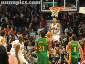 Derrick Rose of the Chicago Bulls dunks vs New Orleans Hornets Mardi Gras Madness March 7 2011