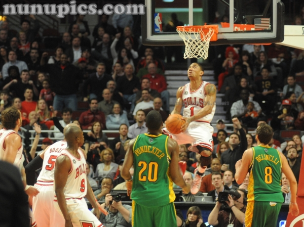 Derrick Rose of the Chicago Bulls dunks vs New Orleans Hornets Mardi Gras Madness March 7 2011