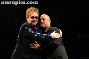 Elton John and Billy Joel embrace onstage in Chicago 2009
